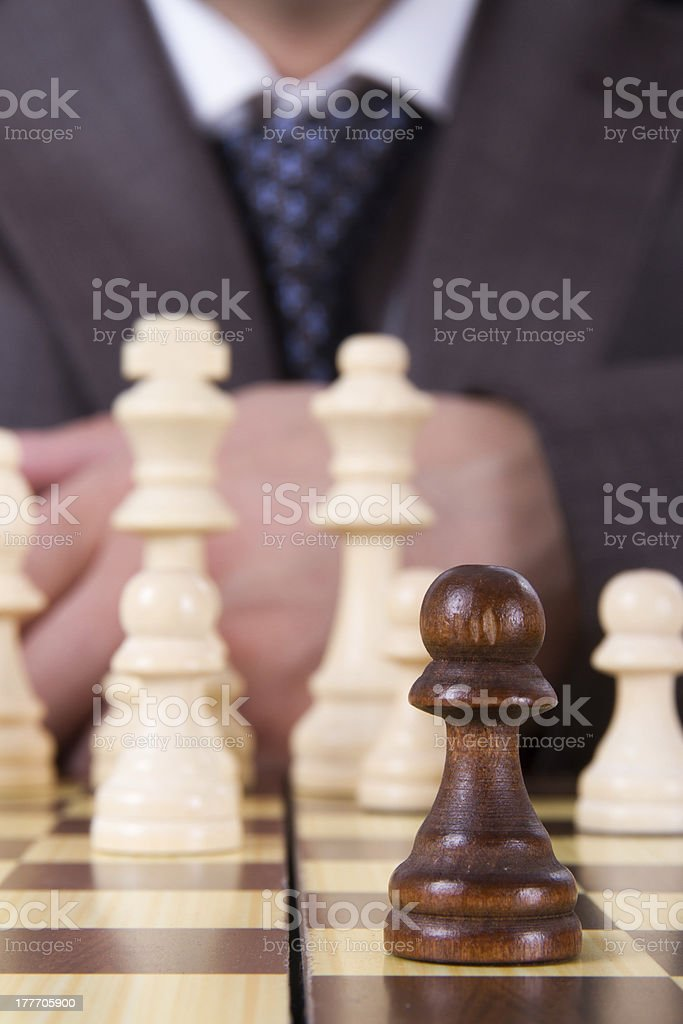 Businessman Focused on Pawn royalty-free stock photo