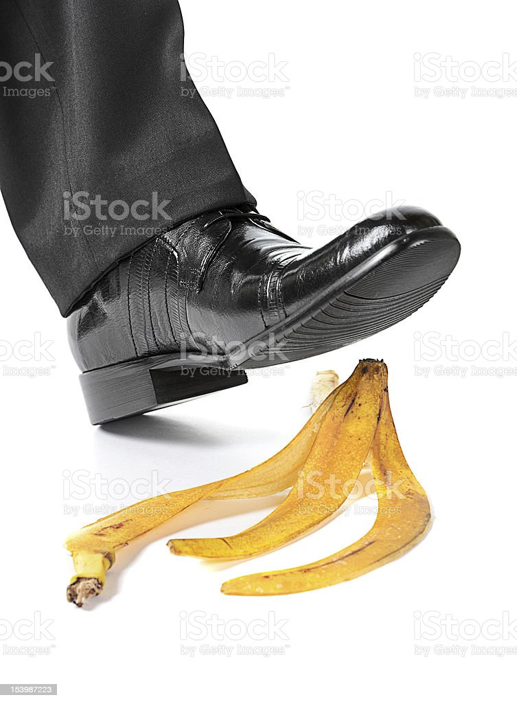 Businessman foot on a banana peel royalty-free stock photo