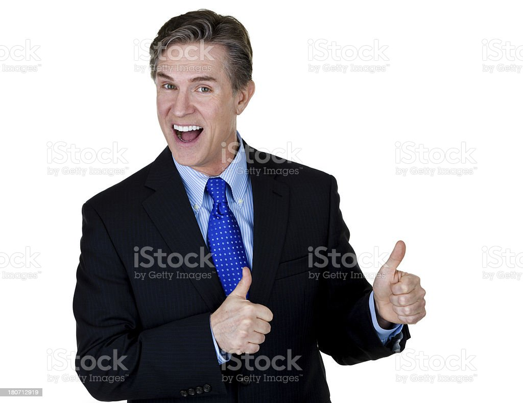 Businessman gesturing thumbs up royalty-free stock photo