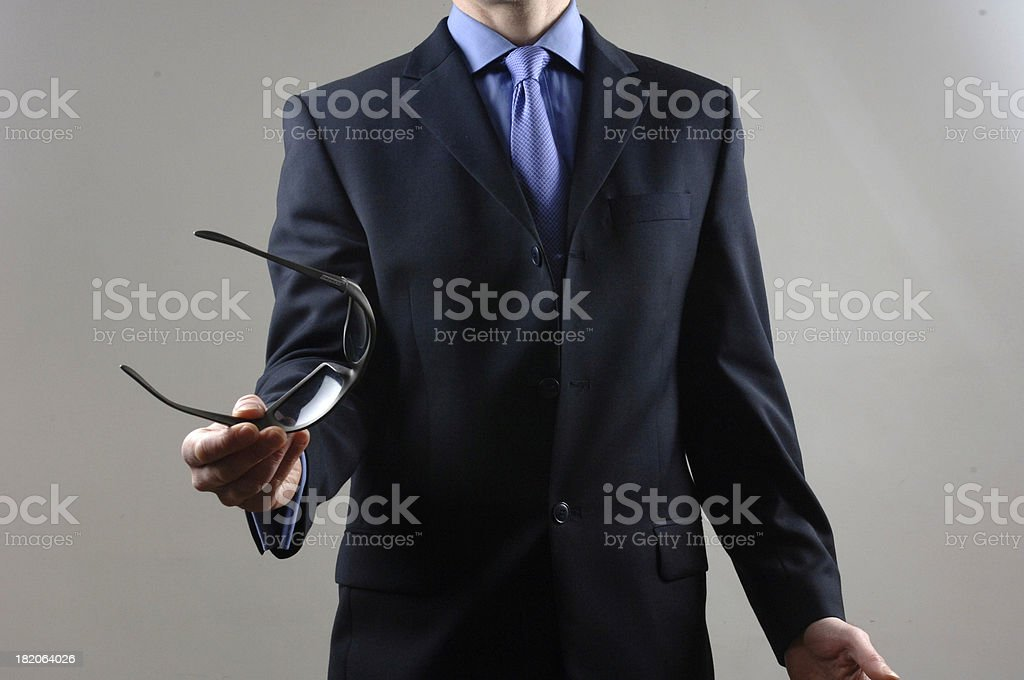 Businessman gesturing with sunglasses royalty-free stock photo