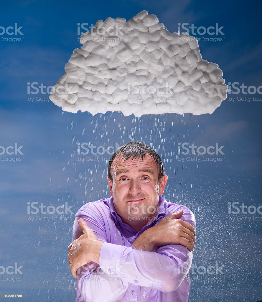Businessman gets rained on by storm cloud royalty-free stock photo