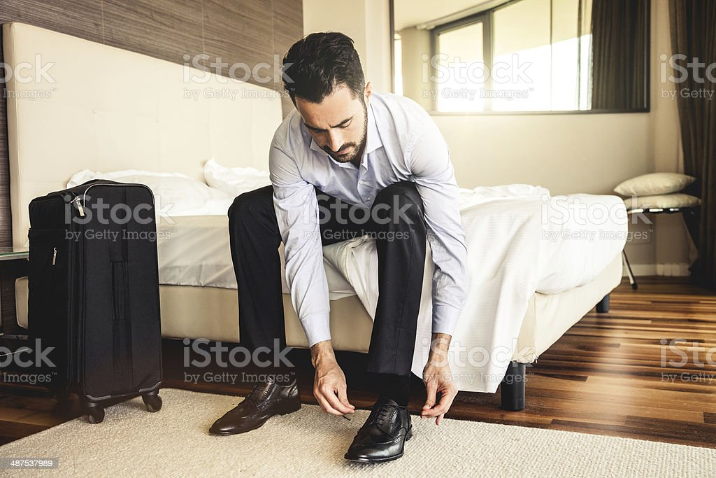 Businessman getting dressed in the morning stock photo