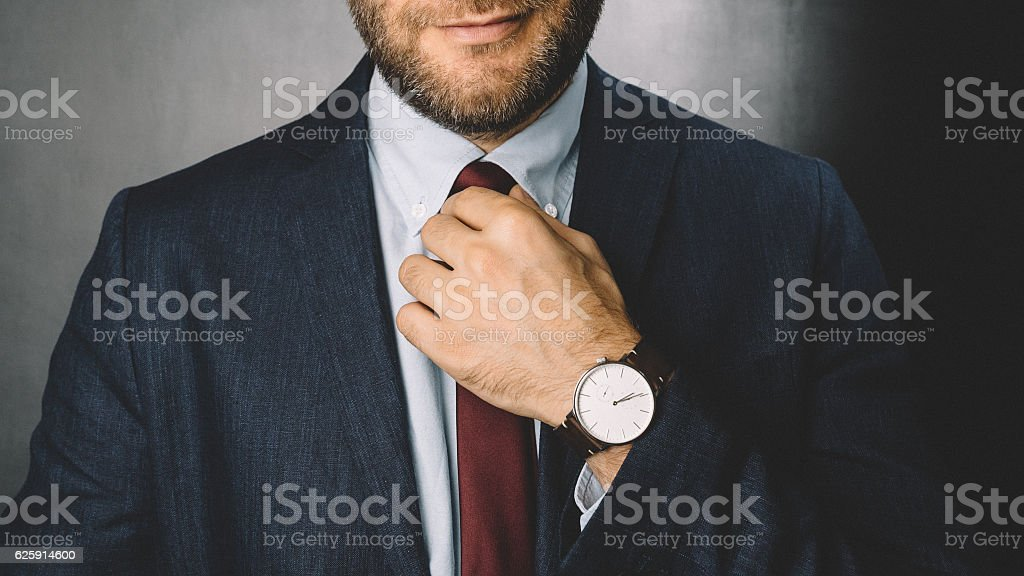 Businessman getting dressed stock photo