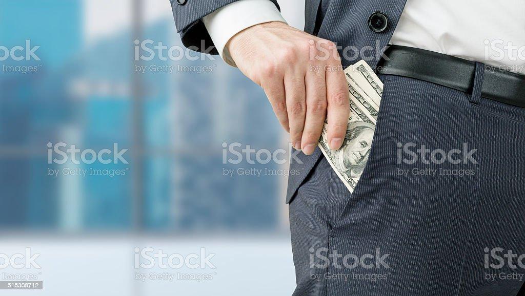 Businessman getting money stock photo
