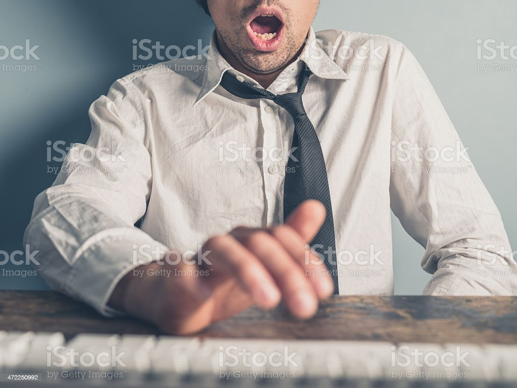 Businessman getting satisfaction from online content stock photo