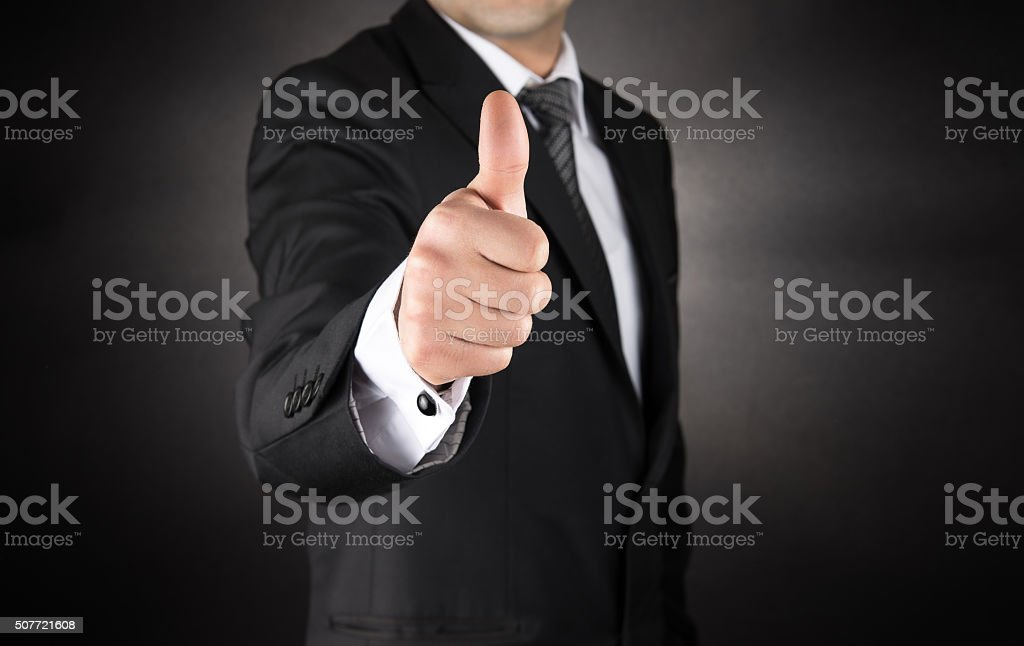 Businessman Gives a Thumb Up stock photo