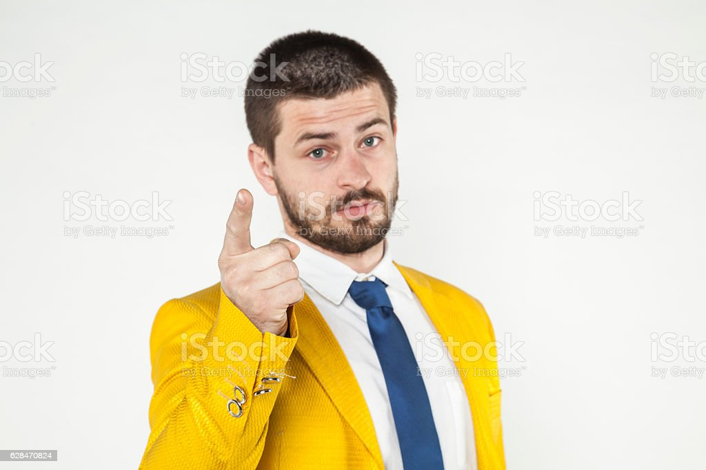 businessman gives a warning, threatening finger stock photo