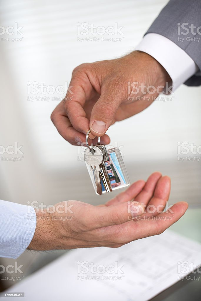 Businessman gives keys to the house royalty-free stock photo