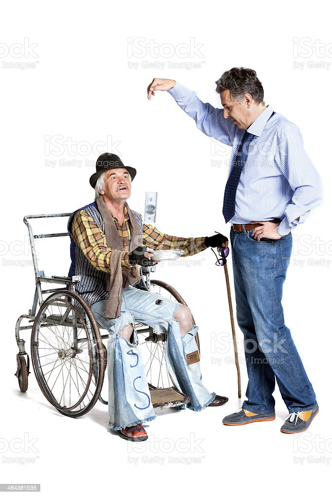 businessman gives money to the homeless royalty-free stock photo