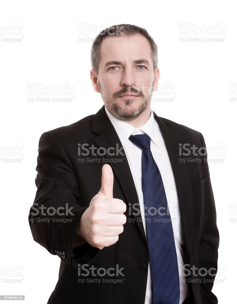 Businessman gives you thumbs up stock photo