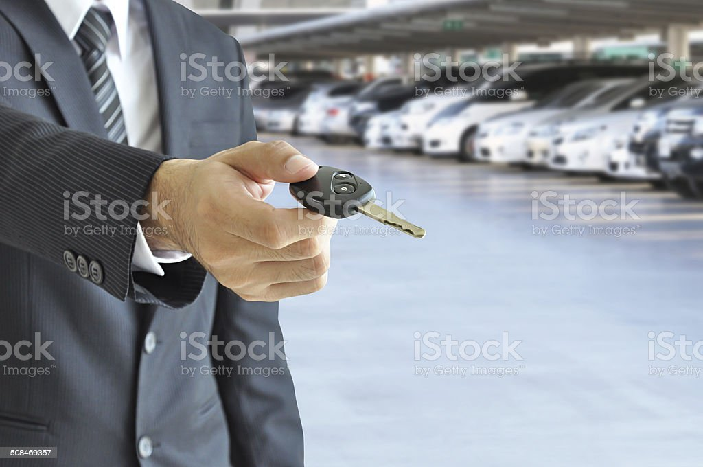 Businessman giving a car key -car sale & rental concept stock photo