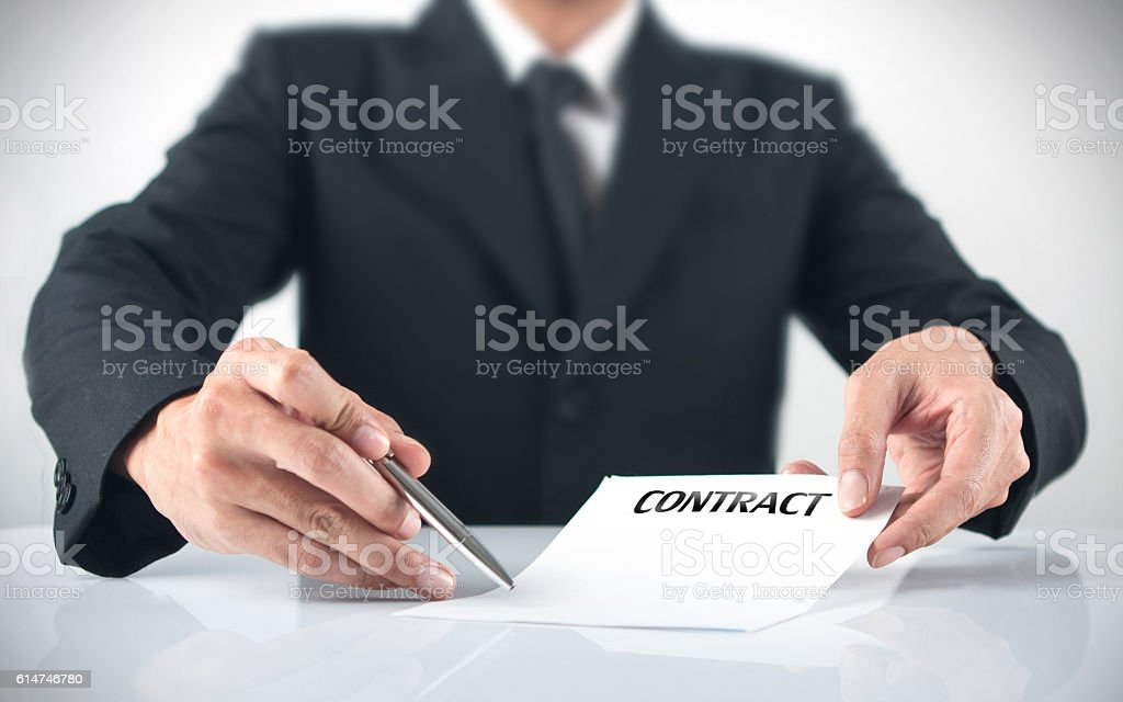 businessman giving  a contract stock photo