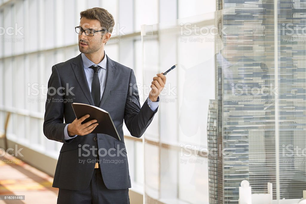 Businessman giving a speech in a conference/meeting room stock photo