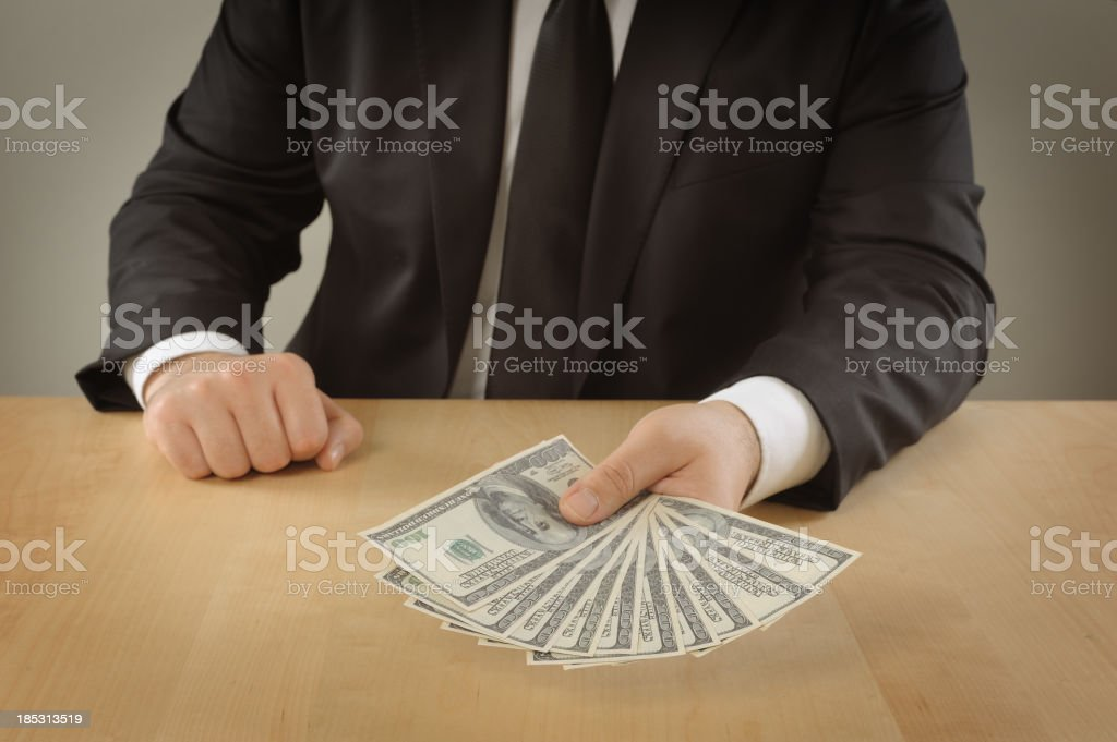 Businessman giving a stuck of money royalty-free stock photo