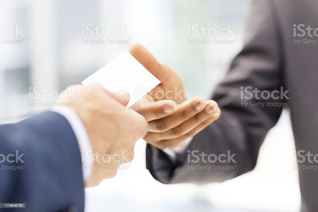 Businessman Giving Business Card To Client royalty-free stock photo