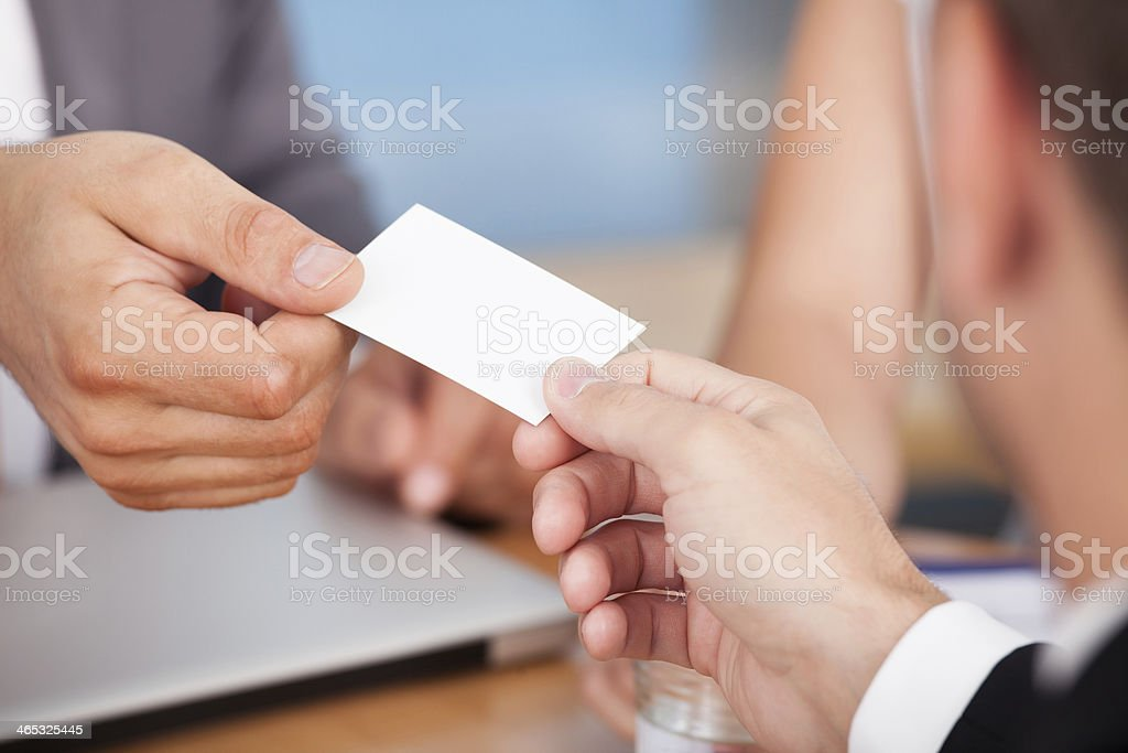 Businessman Giving Card stock photo