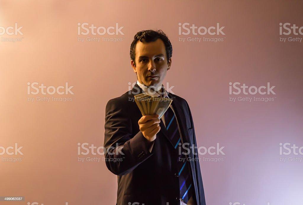 Businessman Giving Dollars stock photo