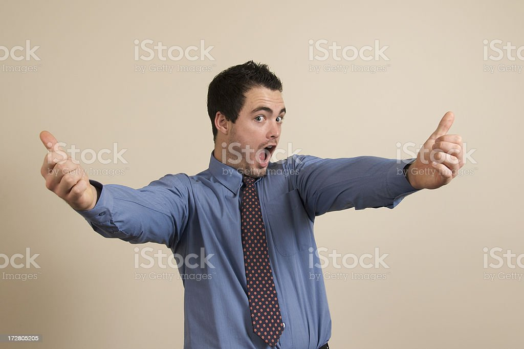 Businessman giving double thumbs up stock photo