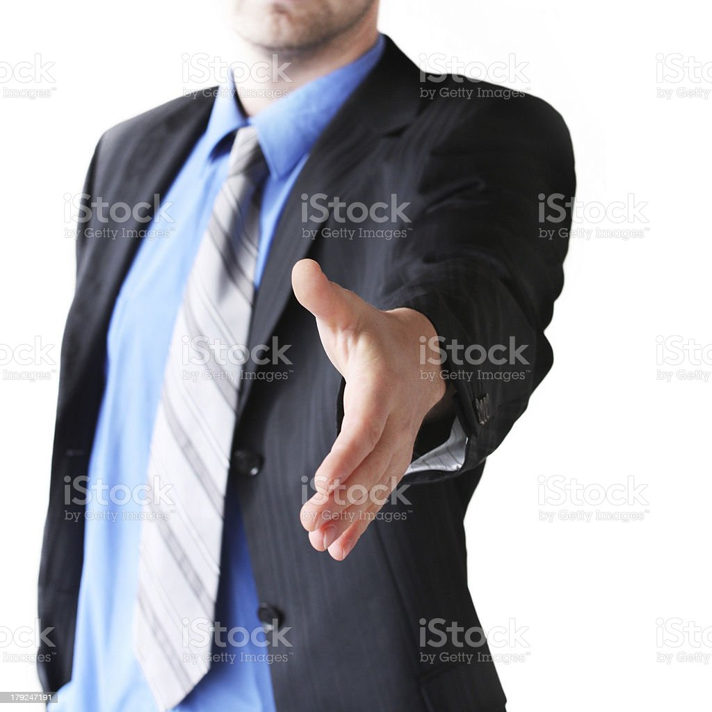 Businessman giving his hand for a handshake on white background stock photo