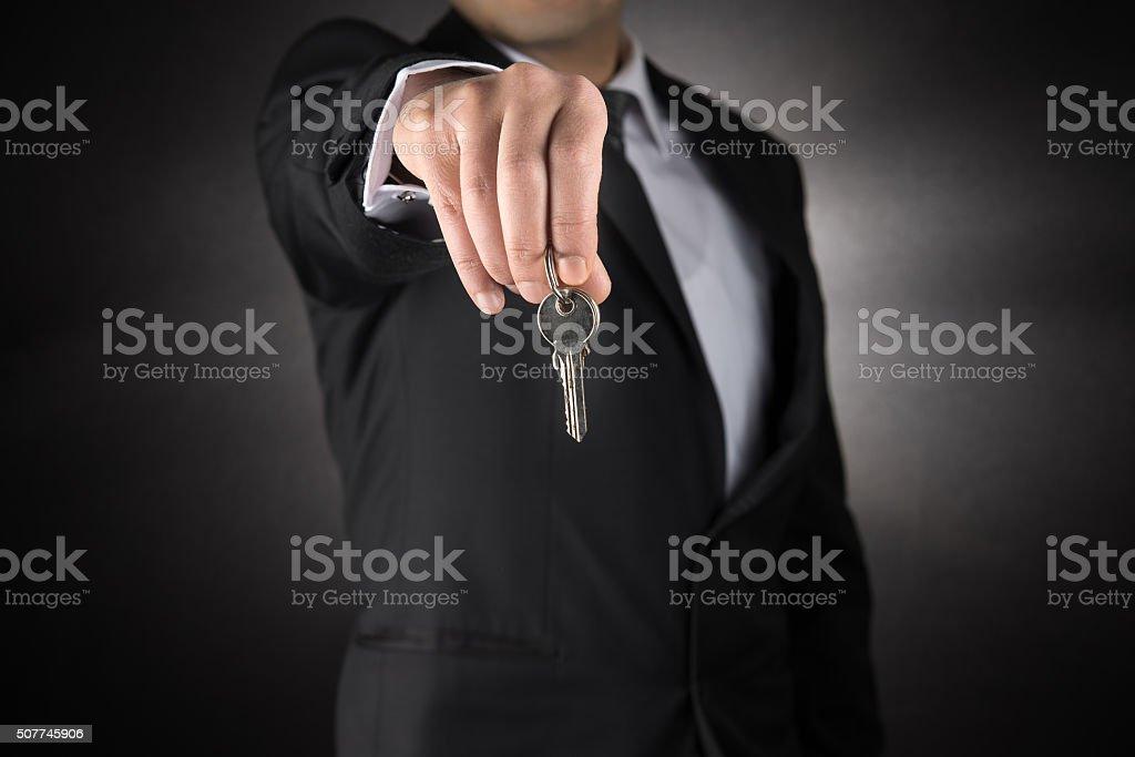 Businessman Giving House Keys stock photo