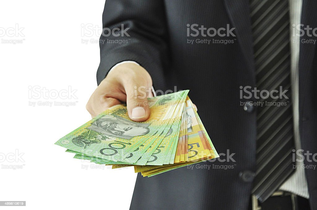 Businessman giving money  - Australian dollars royalty-free stock photo