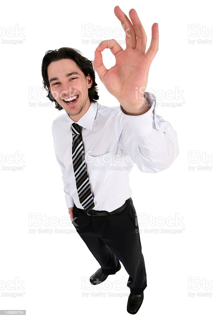 Businessman giving OK gesture royalty-free stock photo