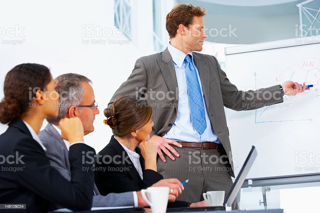 Businessman giving presentation at a meeting royalty-free stock photo
