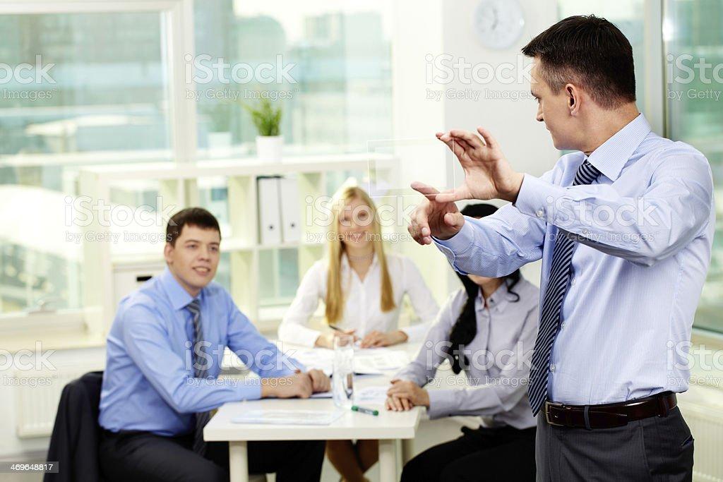Businessman giving presentation at meeting stock photo