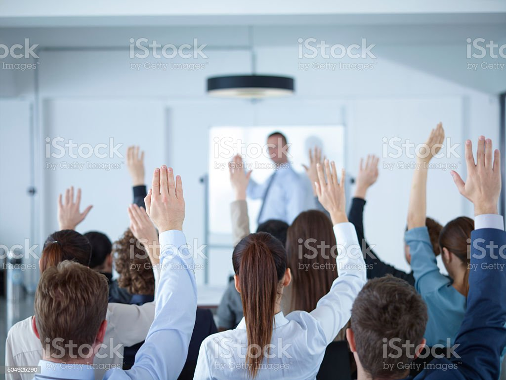Businessman giving presentation at meeting stock photo