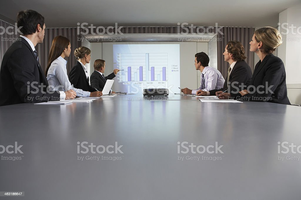 Businessman Giving Presentation In Conference Room stock photo