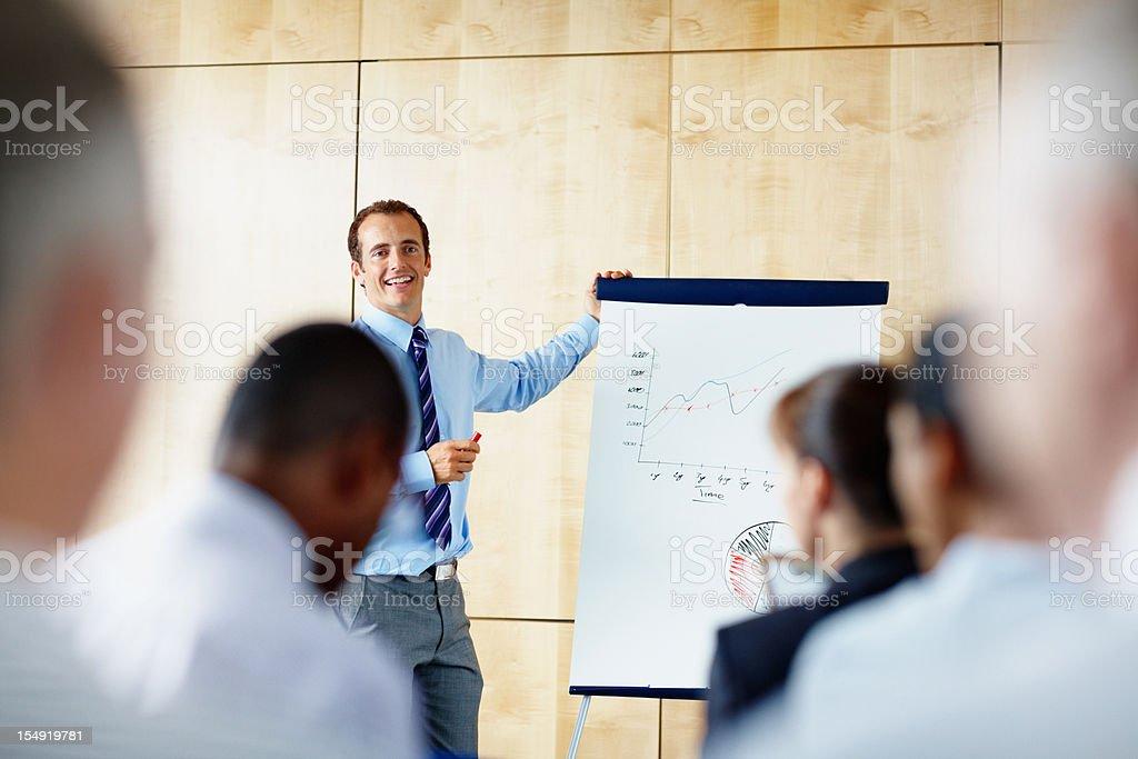 Businessman giving presentation royalty-free stock photo