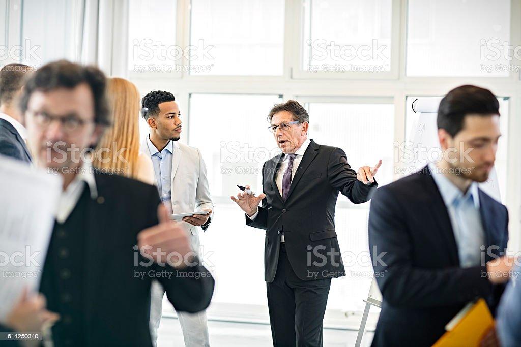 businessman giving  presentation stock photo