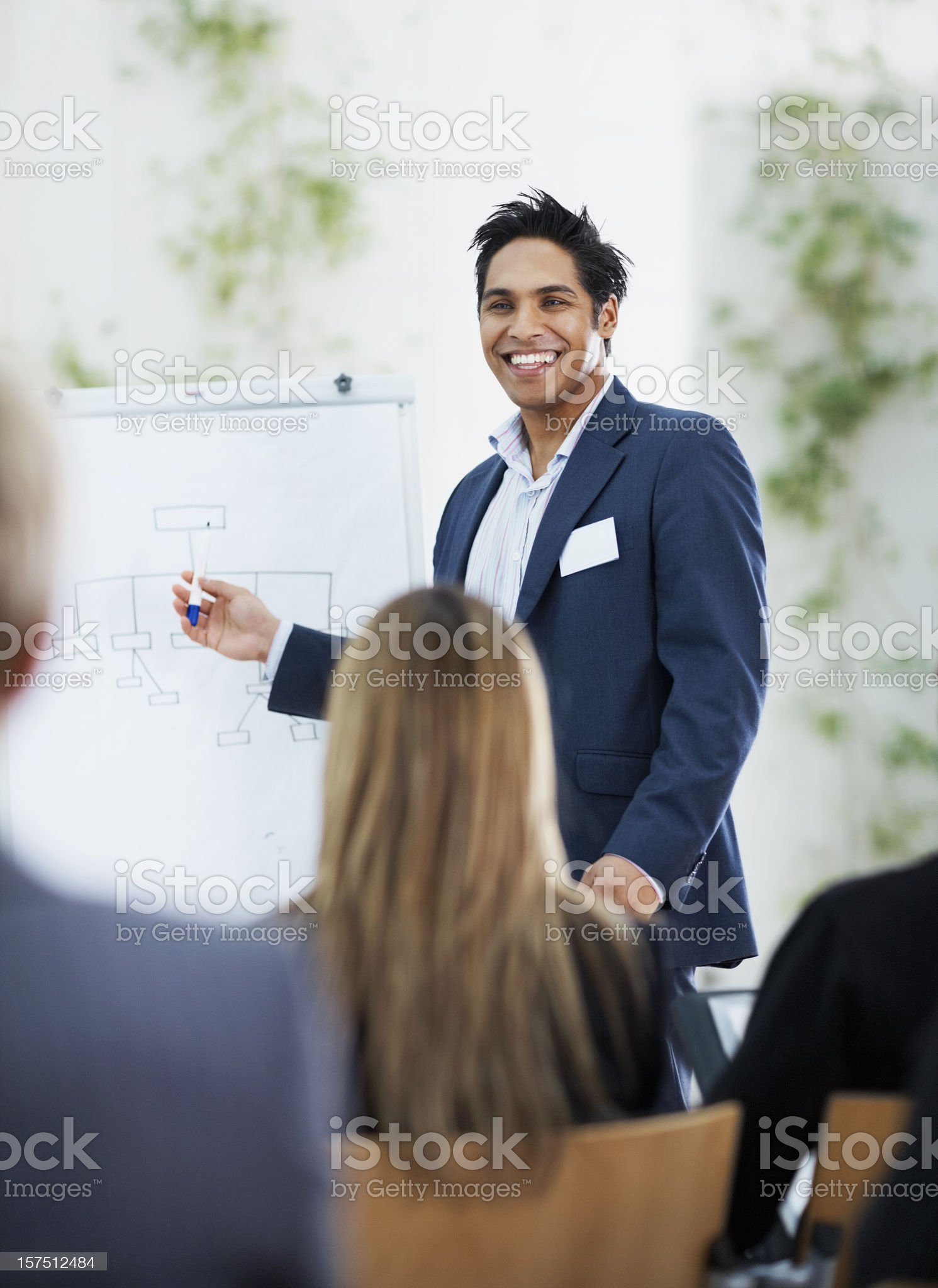 Businessman giving presentation to colleagues royalty-free stock photo