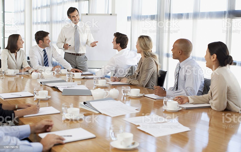 Businessman giving presentation to his colleagues royalty-free stock photo
