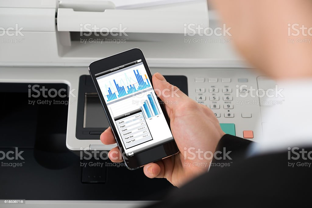Businessman Giving Print Command On Smart Phone stock photo