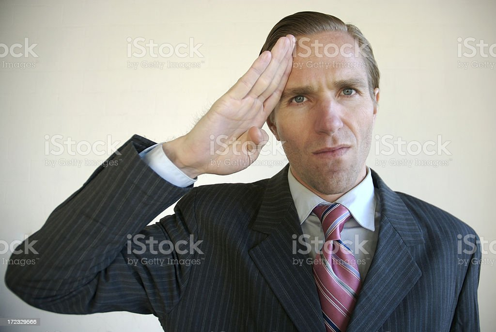 Businessman Giving the Camera a Military Salute royalty-free stock photo