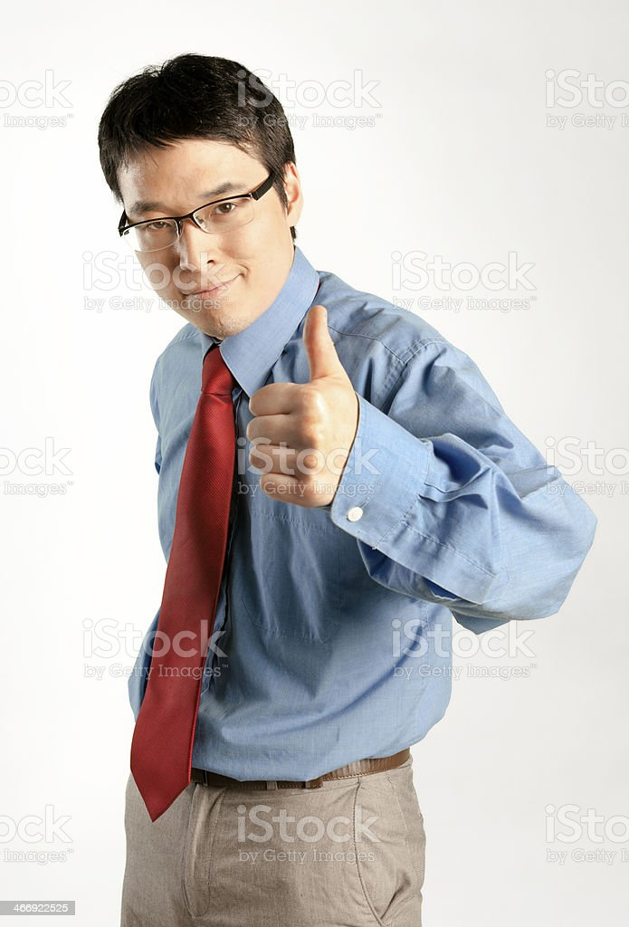 Businessman giving the thumb up royalty-free stock photo