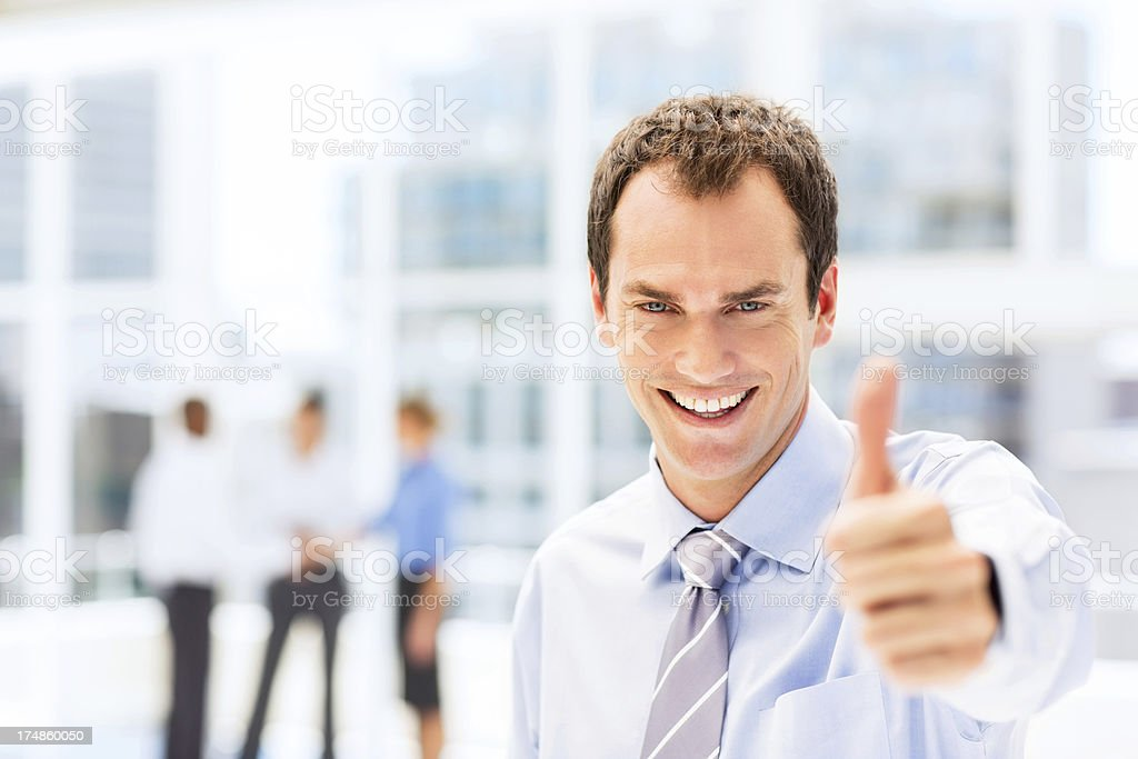 Businessman Giving Thumbs Up royalty-free stock photo