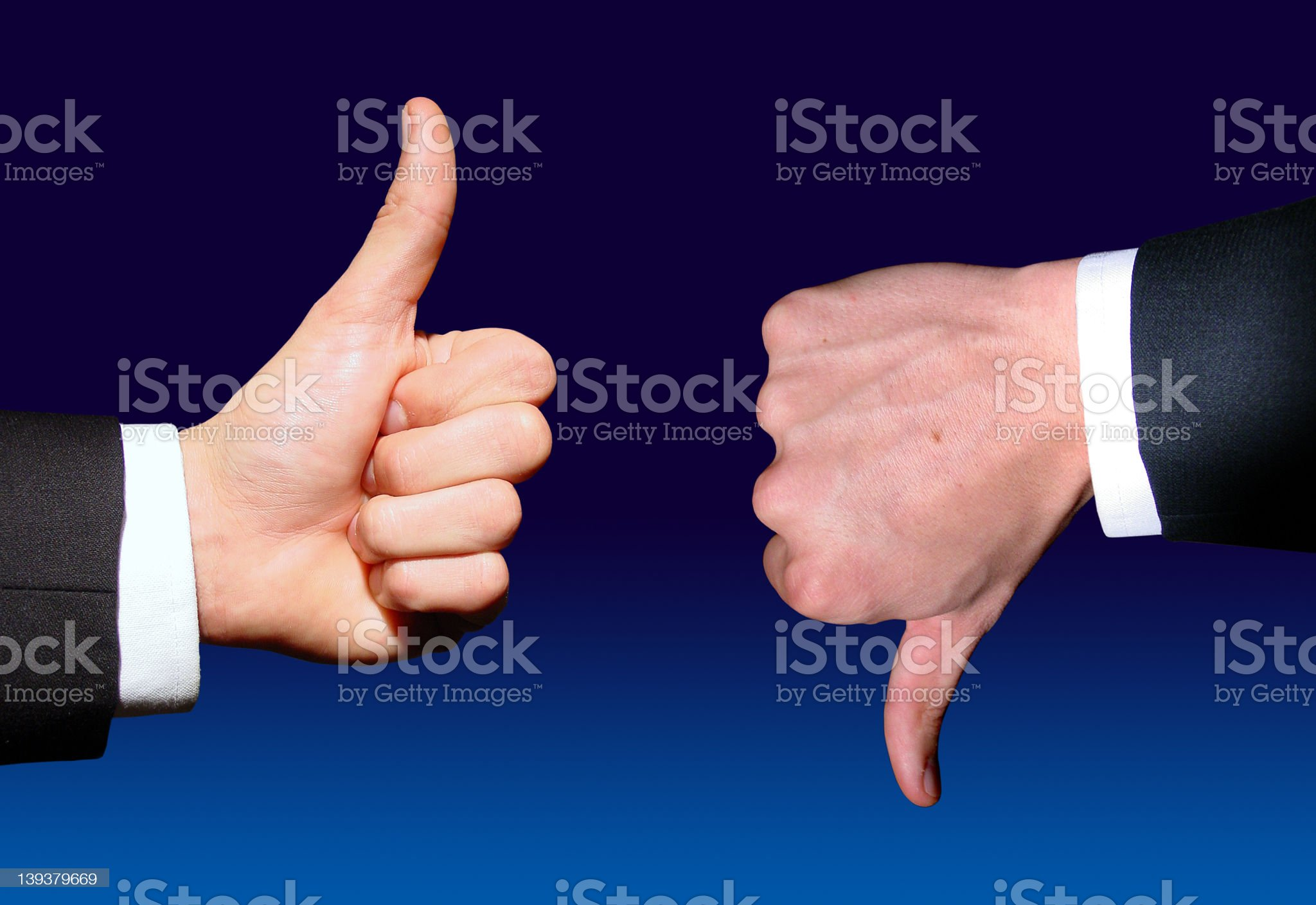 Businessman giving thumbs up while another gives thumbs down royalty-free stock photo