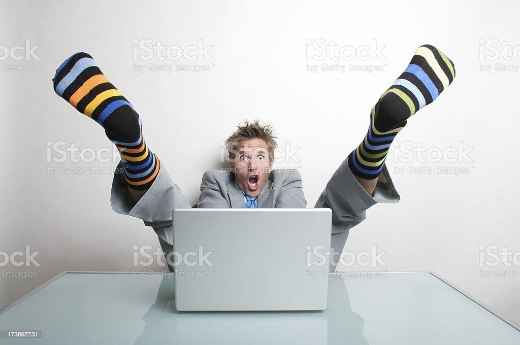 Businessman Goes Socks-Up at his Computer royalty-free stock photo