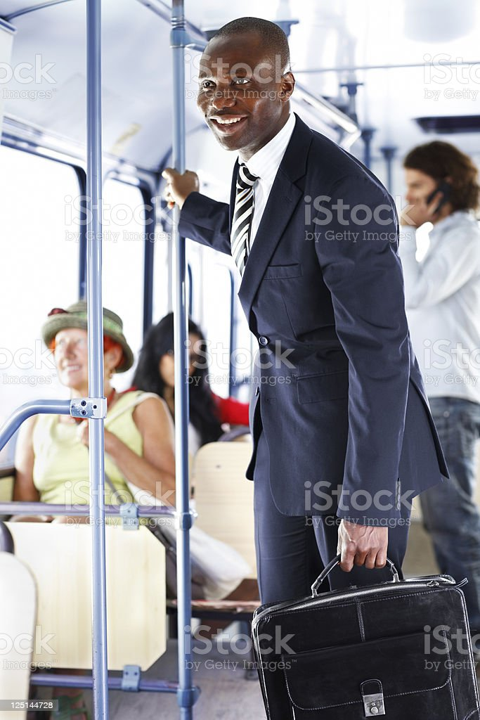 businessman goes to work by  city bus stock photo
