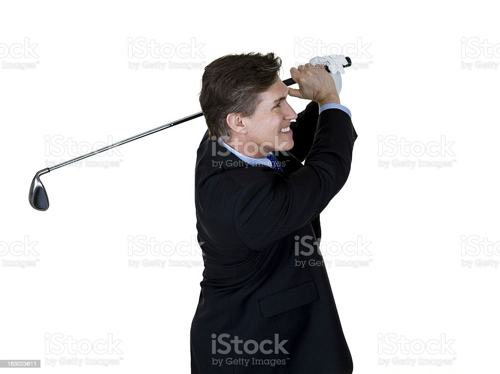 Businessman golfing royalty-free stock photo