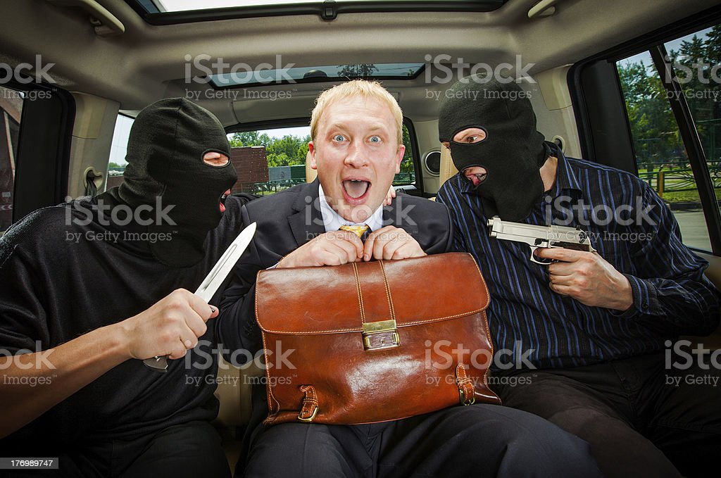 businessman grasped in hostages. royalty-free stock photo