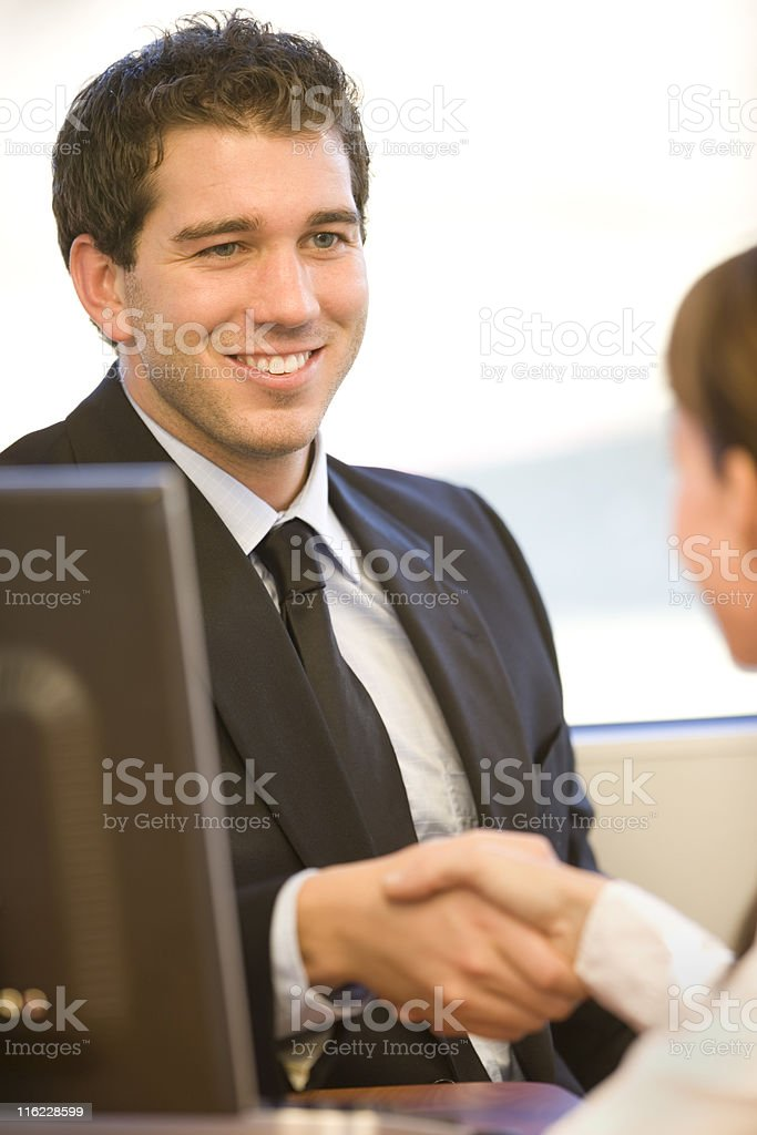 Businessman Greeting A Customer royalty-free stock photo