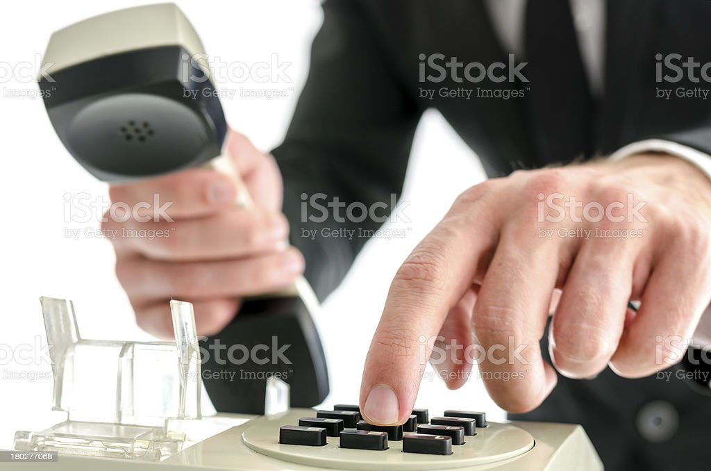 Businessman hand dialing a phone number royalty-free stock photo