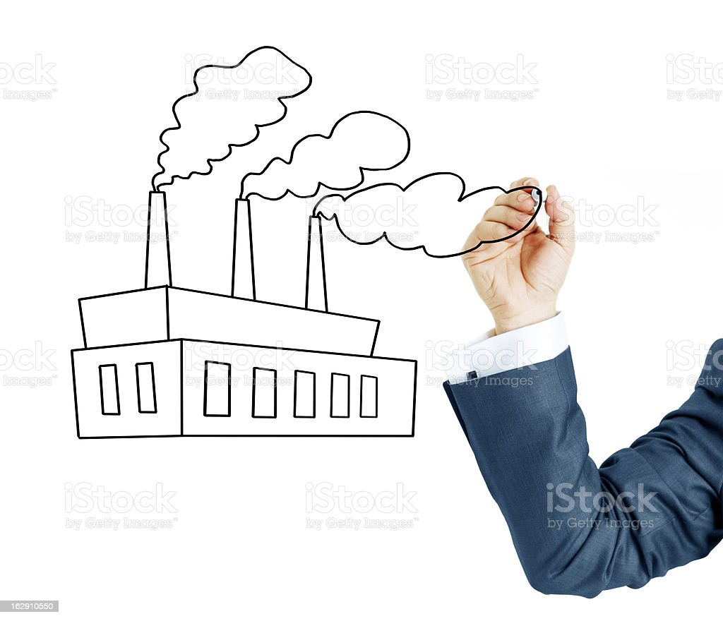 Businessman hand Drawing a factory royalty-free stock photo