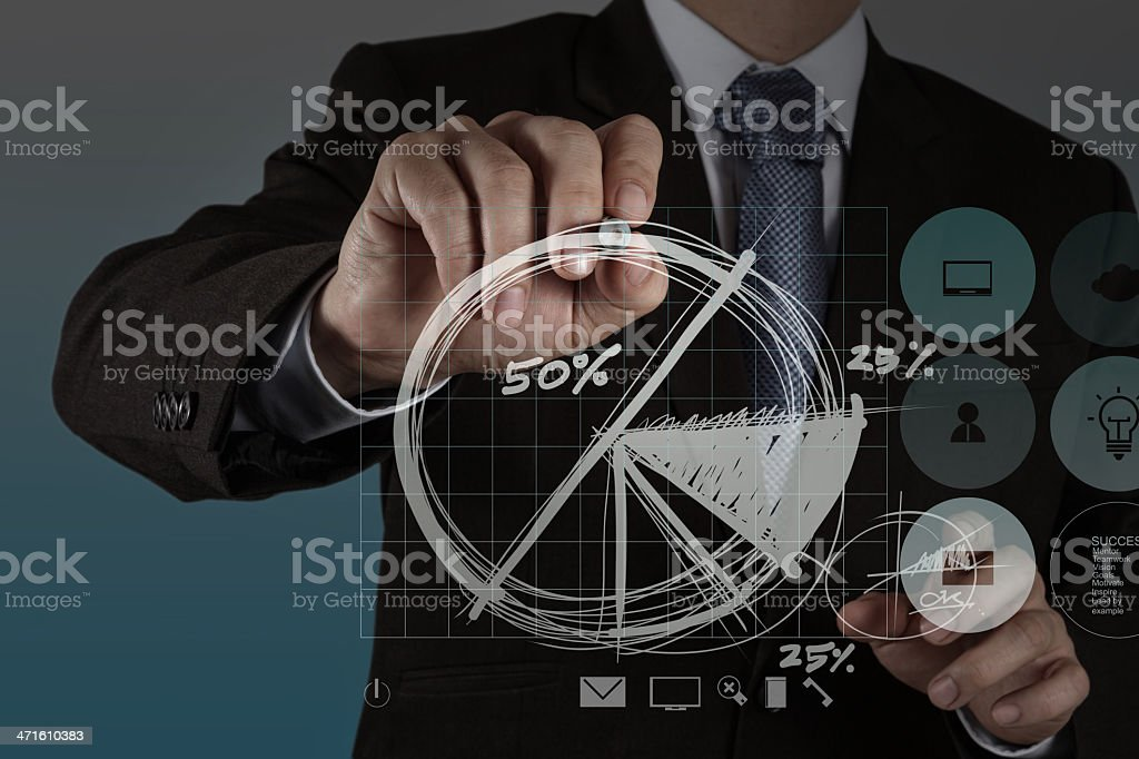 businessman hand drawing a pie chart royalty-free stock photo
