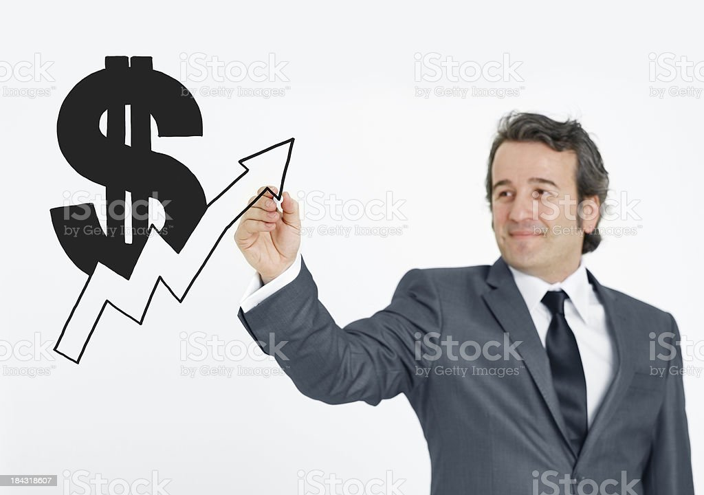 Businessman Hand Drawing Dollar Sign royalty-free stock photo