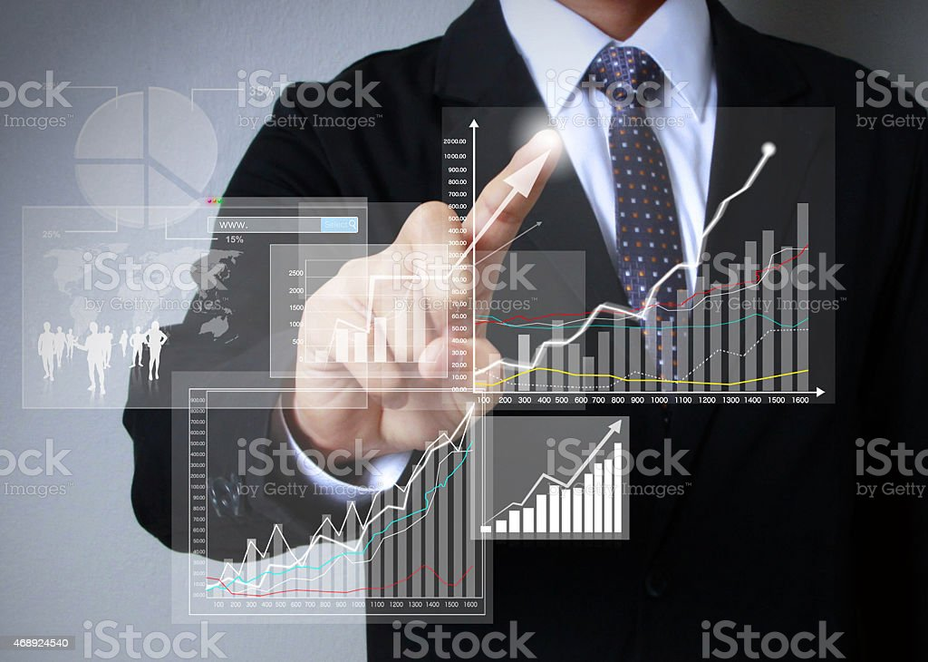 Businessman hand drawing virtual chart business on touch screen stock photo
