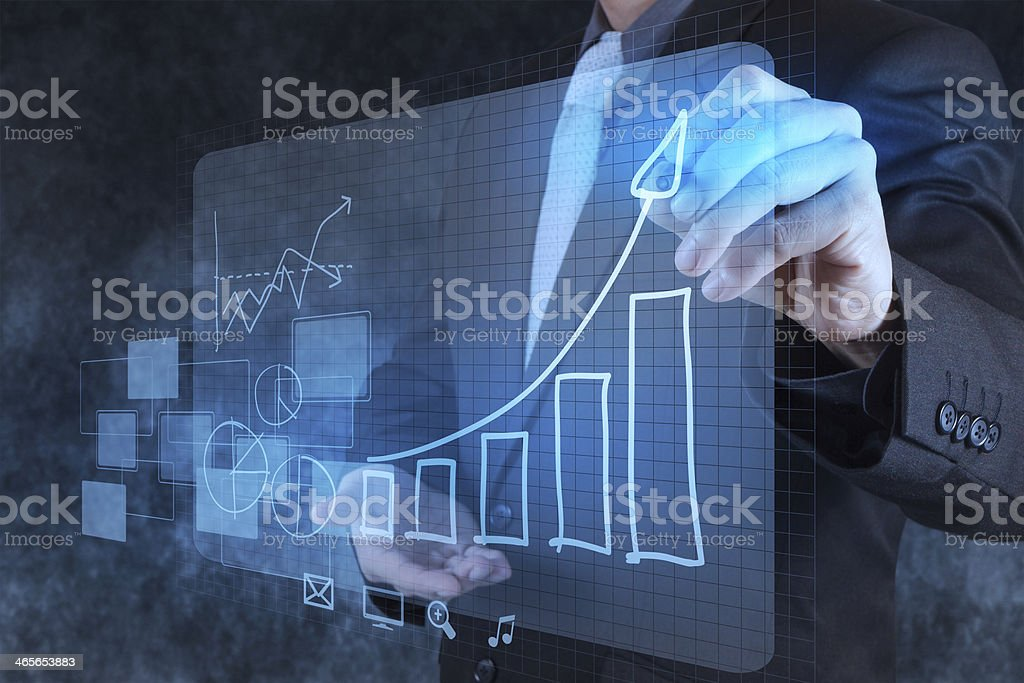 businessman hand drawing virtual chart business royalty-free stock photo